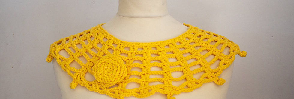 yellow crocheted lace collar with crocheted brooch
