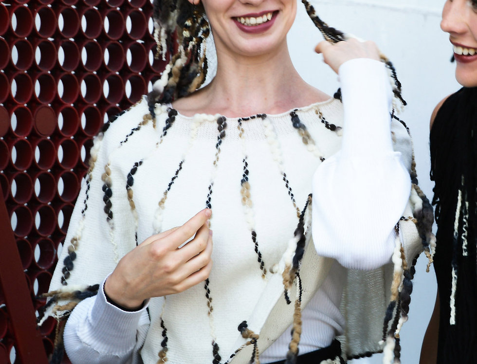 Wearing white reindeer coloured knitted ainikki pelerine