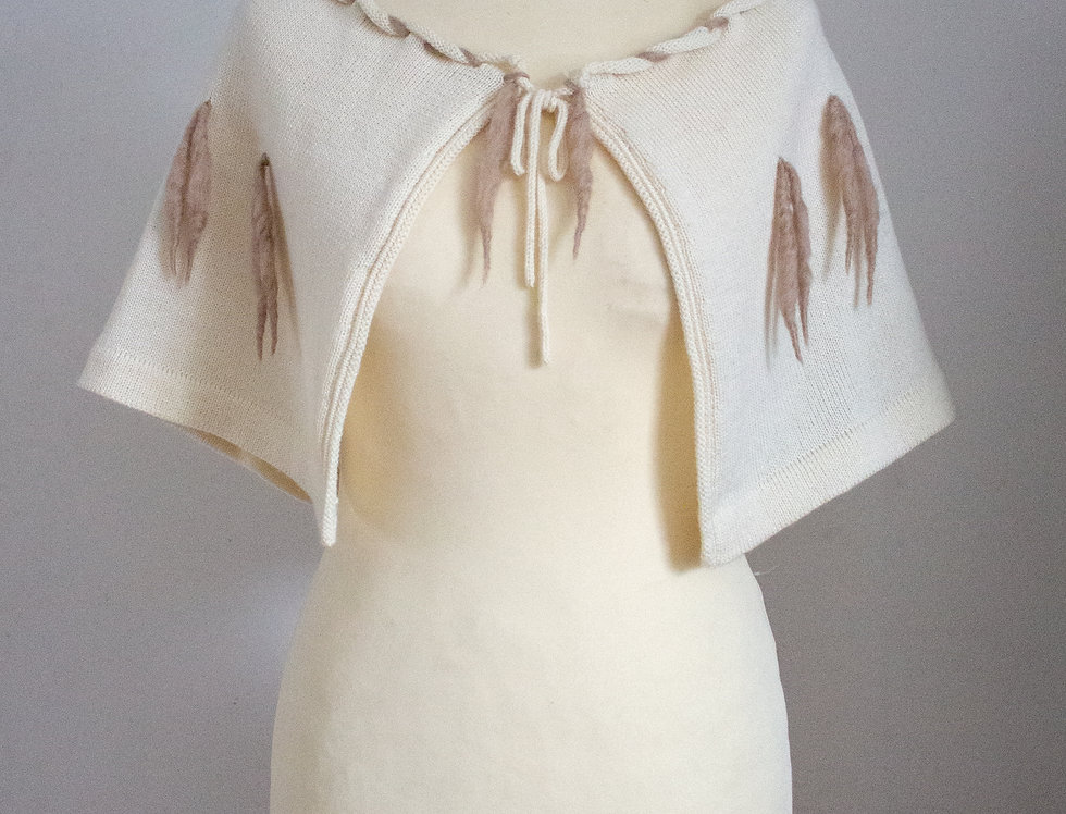 white knitted fairytale cape with woolen fringe decoration