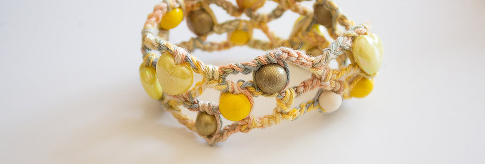 Light yellow crocheted bracelet with wooden pearls