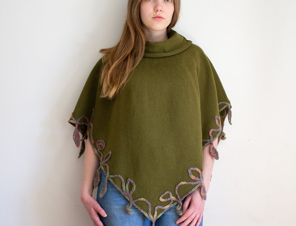 Wearing moss green Mother of Nature poncho front