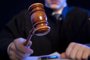 Judge. Male judge in a courtroom strikin