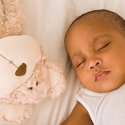 Black baby sleeping .png
