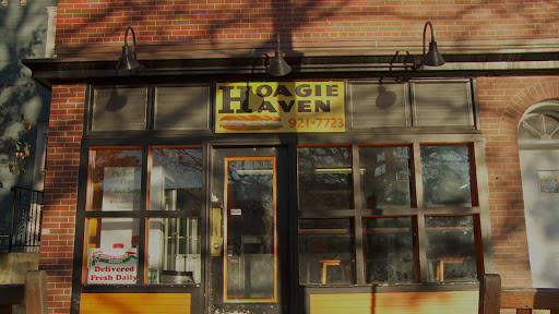 """red brick store front of Hoagie Haven with sign in bottom left corner """"Delivered Fresh Daily"""""""