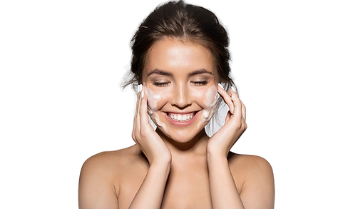 Woman with healthy skin using a moisturizer after a facial