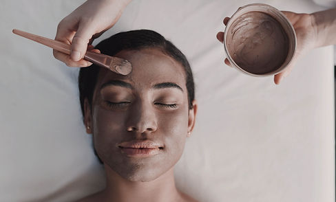 Woman receiving facial mask at spa