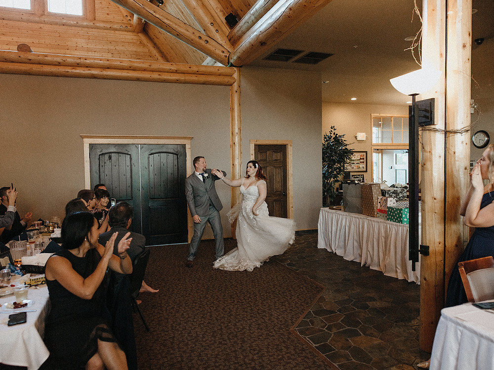 Duluth Wedding Photographer - The Autumn Dog Studio -  groom twirling bride upon entering reception