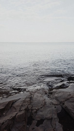 monochromatic image of rocks leading into Lake Superior - taken by Duluth Wedding Photographer Cranberries and Tea Photography