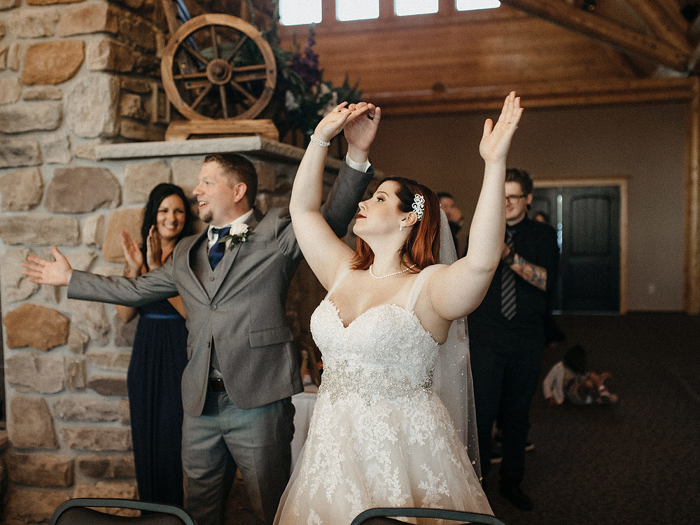 Duluth Wedding Photographer - The Autumn Dog Studio -  bride and groom celebrating entrance into reception