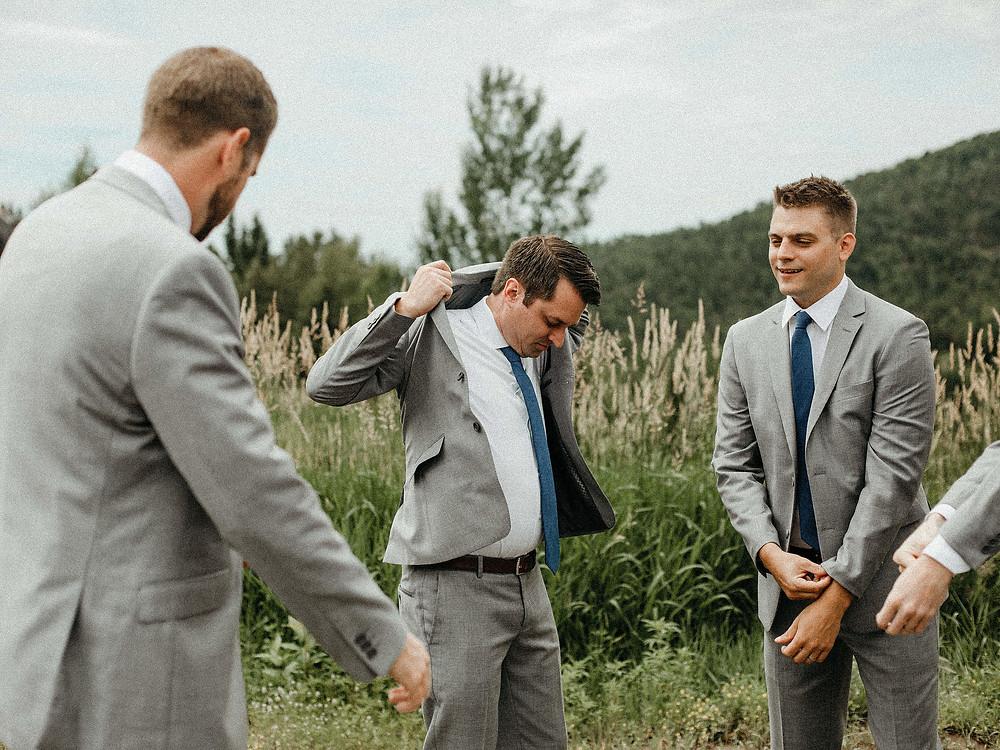 Summit Chalet Wedding - Duluth Wedding Photographer - groomsmen getting dressed