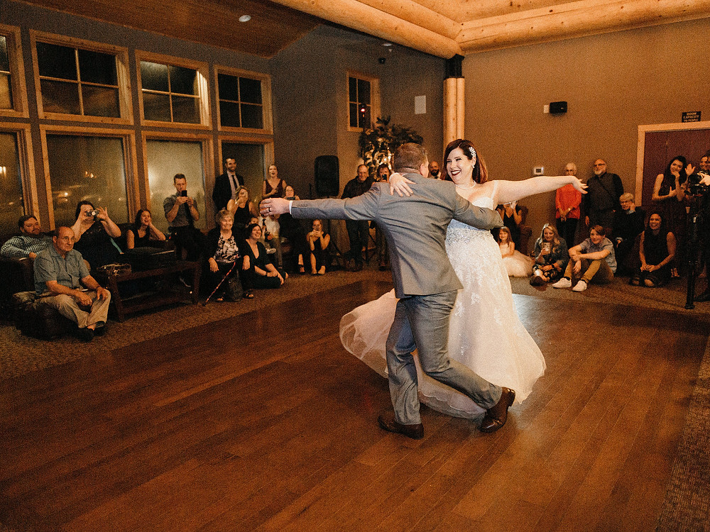 Duluth Wedding Photographer - The Autumn Dog Studio -  bride and groom twirling during first dance