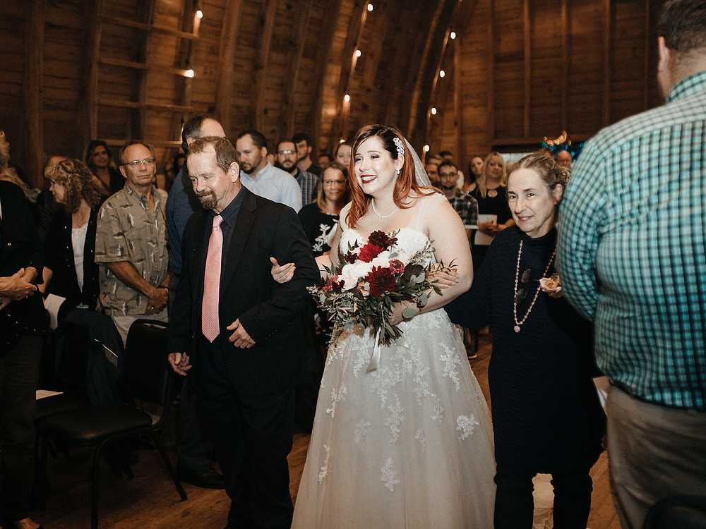 Duluth Wedding Photographer - The Autumn Dog Studio -  bride largely smiling as she approaches altar with parents