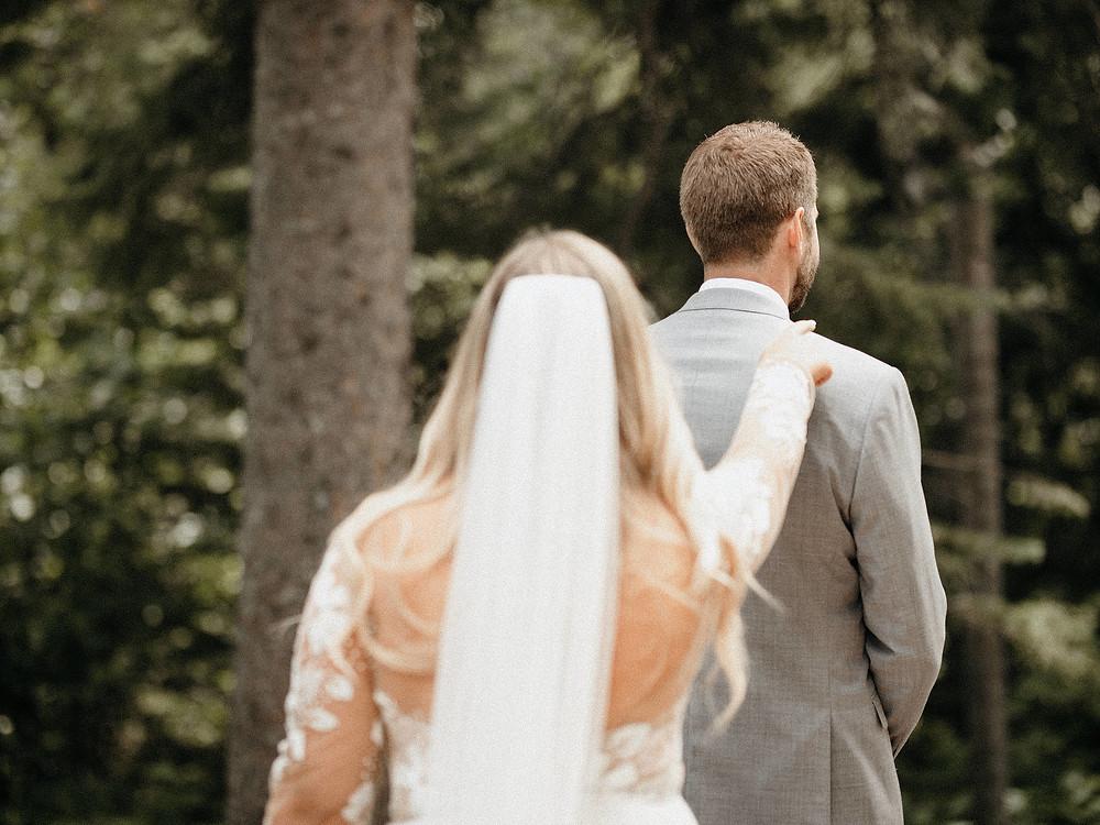 Summit Chalet Wedding - Duluth Wedding Photographer - first look tap