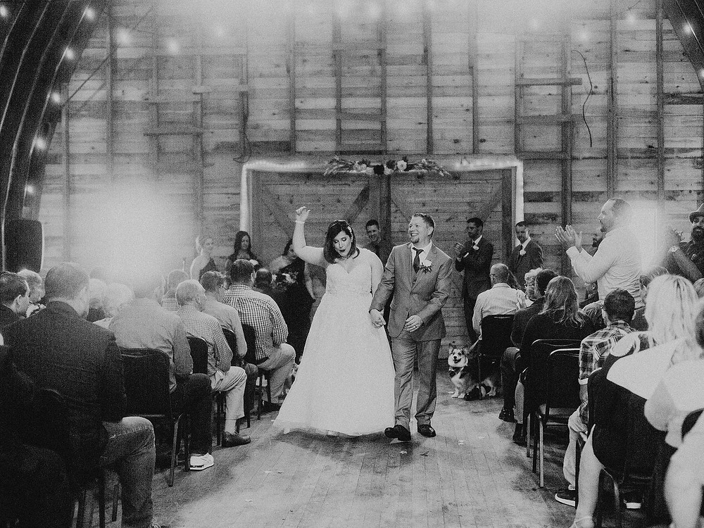 Duluth Wedding Photographer - The Autumn Dog Studio -  bride and groom celebrating marriage during recessional