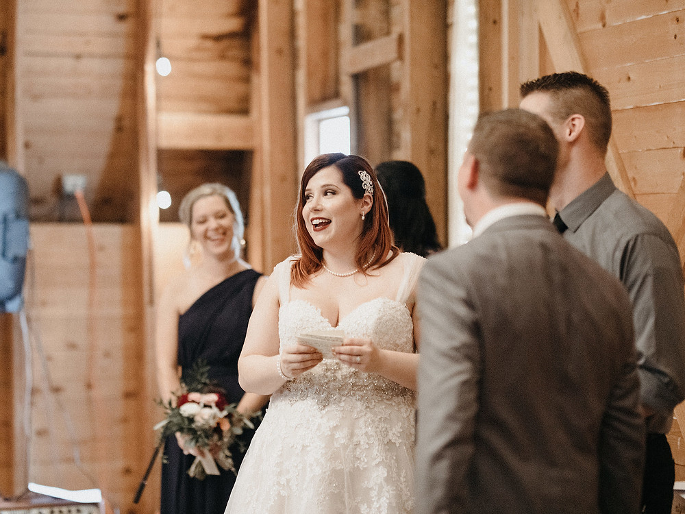 Duluth Wedding Photographer - The Autumn Dog Studio -  bride reciting vows with smile