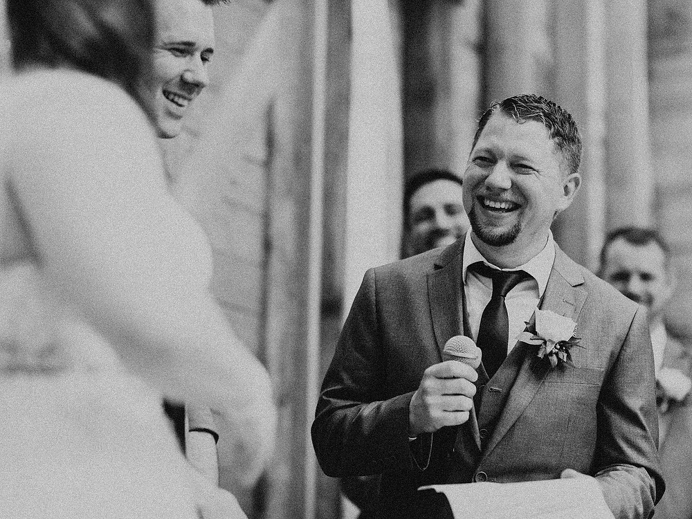 Duluth Wedding Photographer - The Autumn Dog Studio -  groom reciting vows with smile