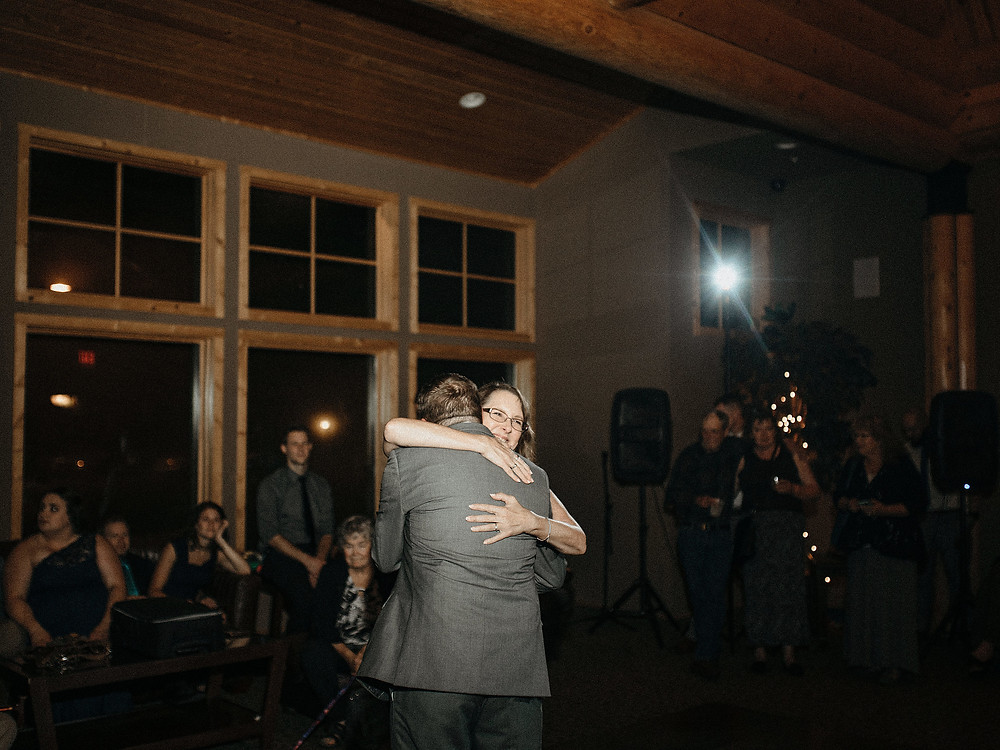 Duluth Wedding Photographer - The Autumn Dog Studio -  groom hugging mom during dance