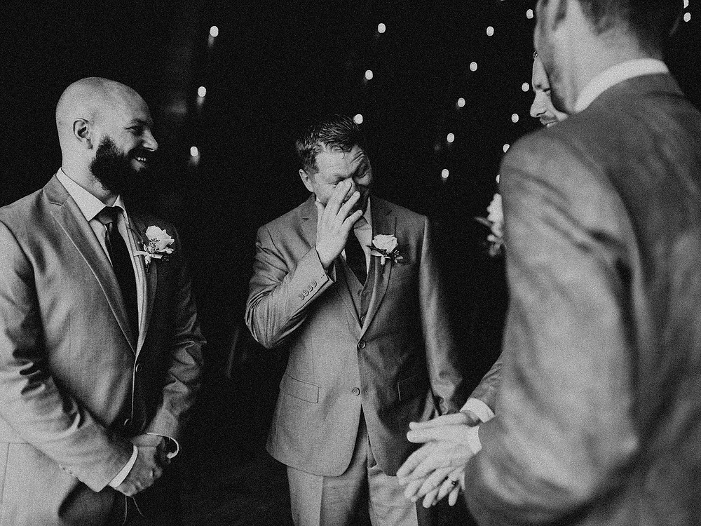 Duluth Wedding Photographer - The Autumn Dog Studio -  groom laughing with groomsmen