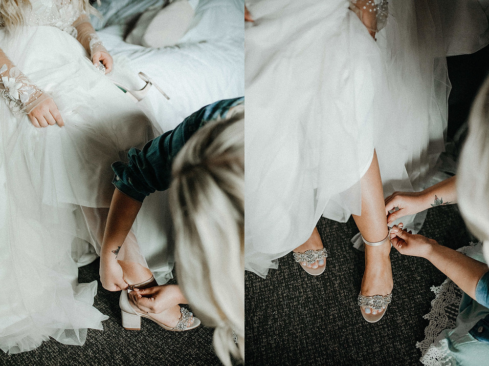 Summit Chalet Wedding - Duluth Wedding Photographer - bride putting on shoes with sister