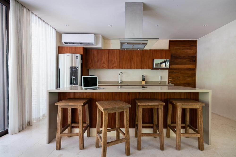 Fotografía de bienes raíces que muestra el uso particular del área. Fotografía de cocina de Copal Tulum.