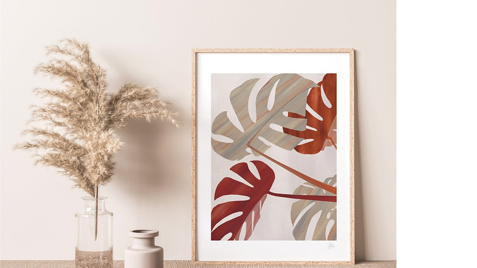 A modern natural toned interior displaying an abstract monstera palm leaf print in rusty brown and beige tones