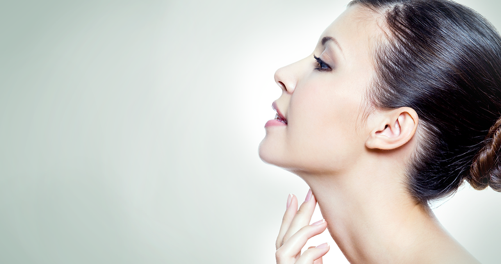 Profile of woman touching her neck