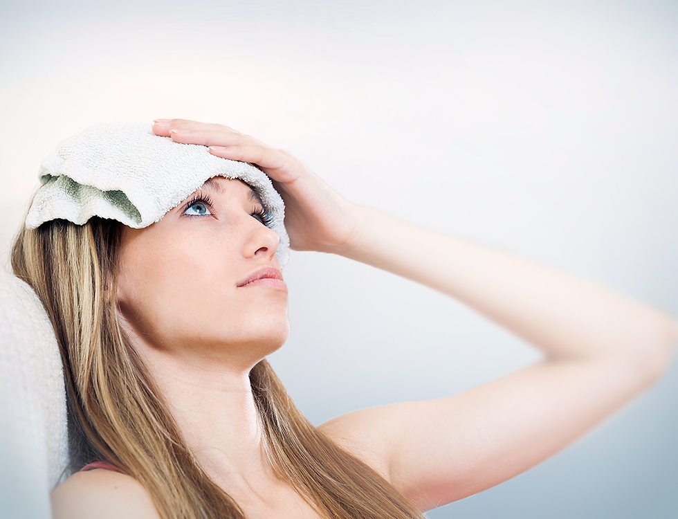 Woman with washcloth on forehead looking up