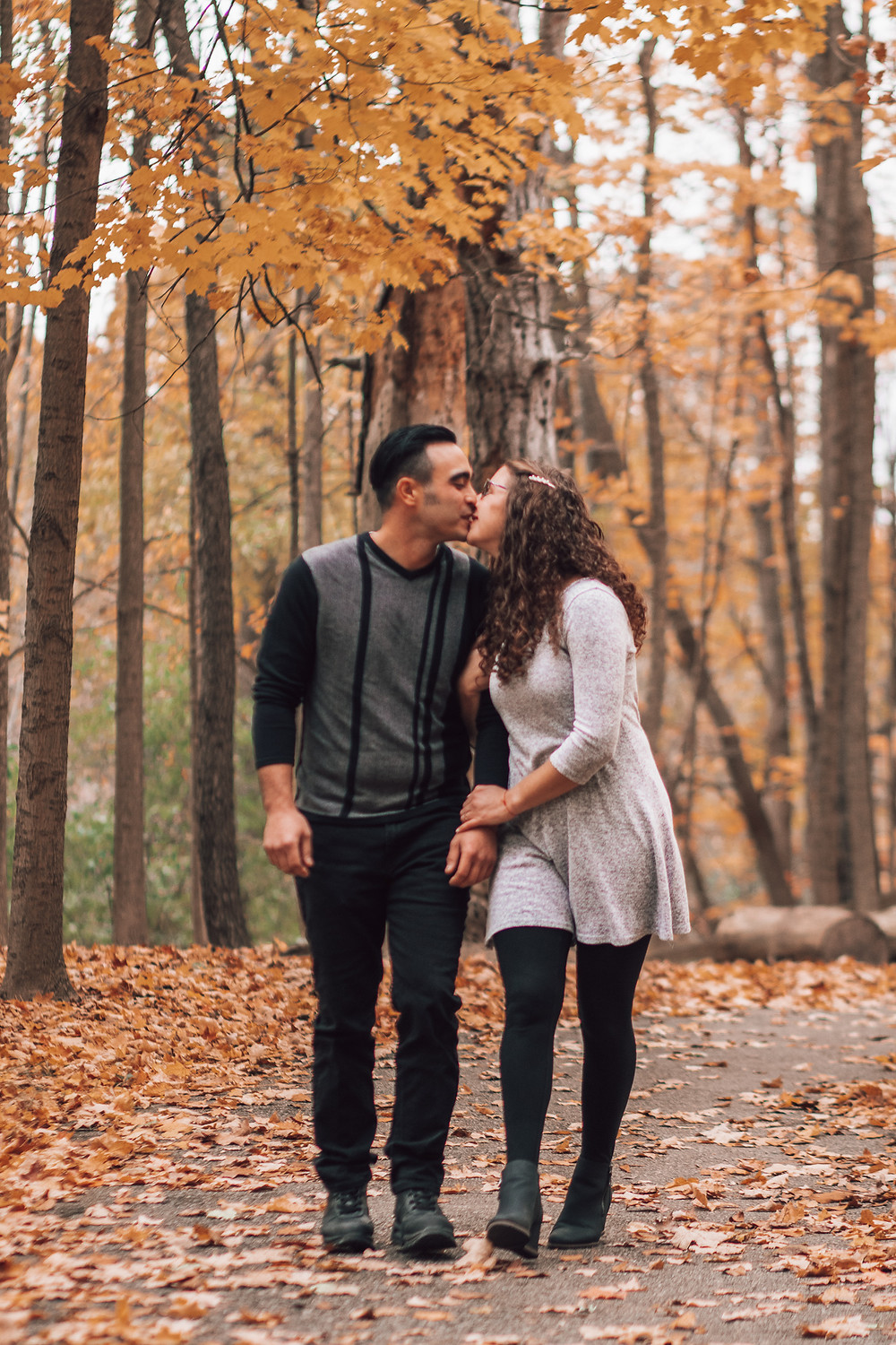 engagement portrait of couple holding hands and walking together