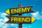 Enemy - Friend signpost with sky backgro