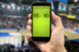 betting man through his smart phone in a
