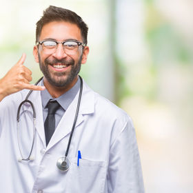 Adult hispanic doctor man over isolated