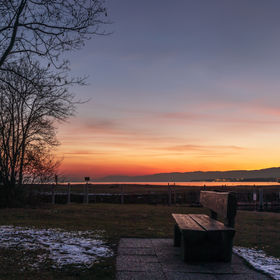 Wooden bench near the lake Leman at the