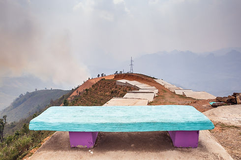 Bright colorful bench in time of hill fi