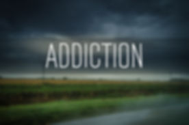 _Addiction_ text on blurry country road