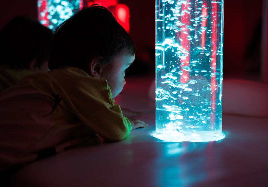 Young kid exploring a multi sensory spac
