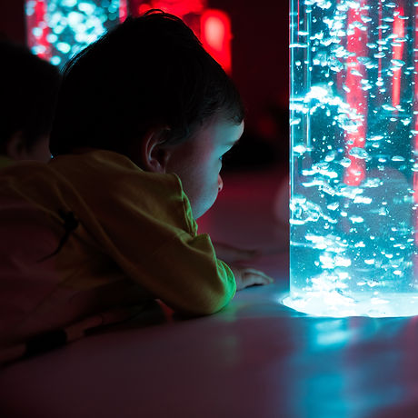 Young kid exploring a multi sensory spac