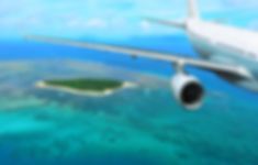 Passenger plane flies over a tropical Is