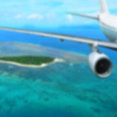 Passenger plane flies over a tropical Is