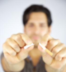 Cigarette being broken in two pieces by