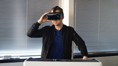 man-wearing-black-jacket-holding-vr-insi