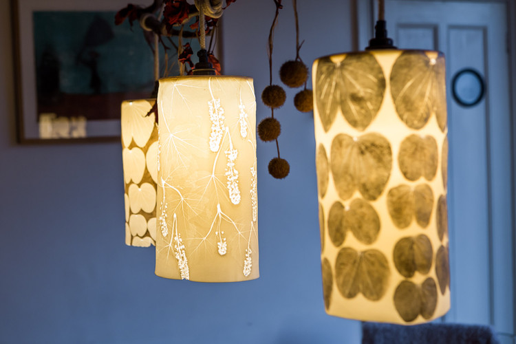 Pendants lights hanging in Chrissy's dining room