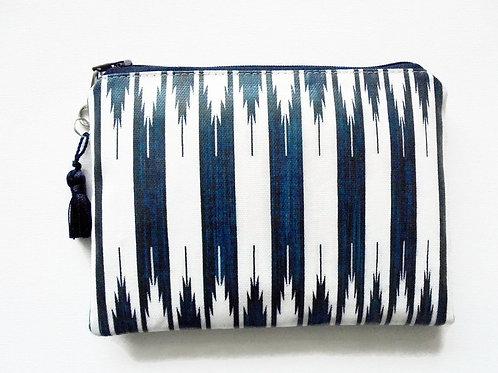 Navy aztec stripe vegan wallet, faux leather zipper bag.
