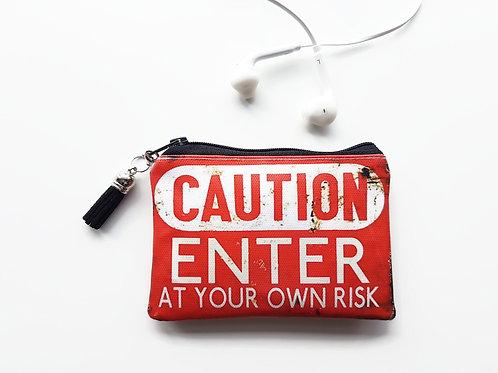 Caution, credit card wallet, lipstick bag, vegan vinyl wallet.