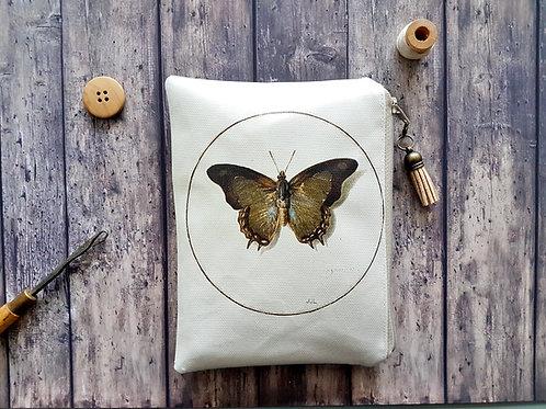 Entomology print, vegan, water resistant zipper wallet.