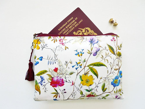 Botanical print vegan vinyl zipper wallet.