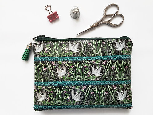 Crane print, vegan, water resistant zipper wallet.