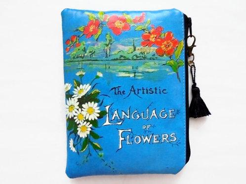 Language of flowers print vegan vinyl zipper pouch.