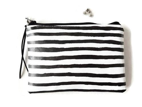 Black and white stripe vegan vinyl zipper wallet.