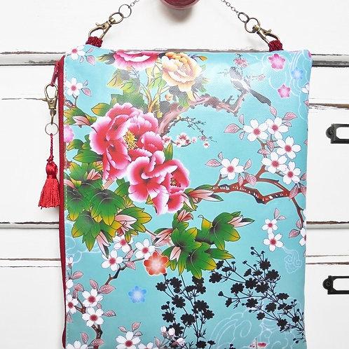 Oriental large hanging cosmetic vegan vinyl bag.