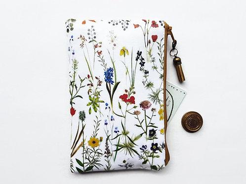 Botanical print ladies vinyl purse.